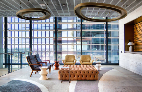 Modern high rise office reception waiting area with quality furniture and lights