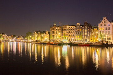Canvas Prints Textures building architecture along canal against reflection of light night
