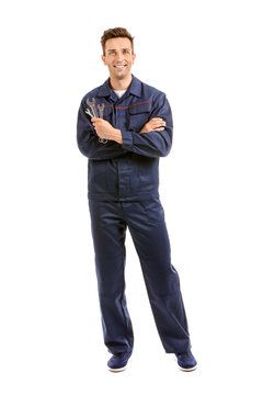 Male car mechanic on white background