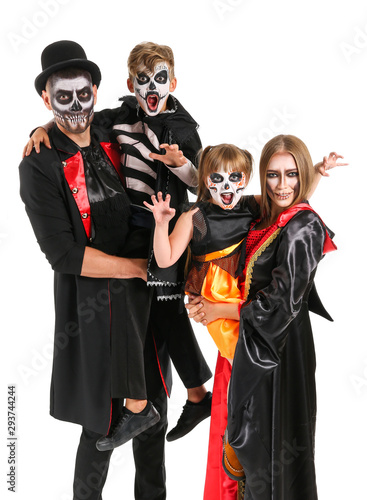 Family in Halloween costumes on white background