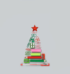 symbol Christmas tree made of stationery, pens, pencils, paper clips, office supplies. new year's concept in office, University, school. Christmas and New Year holiday season. Creative idea design