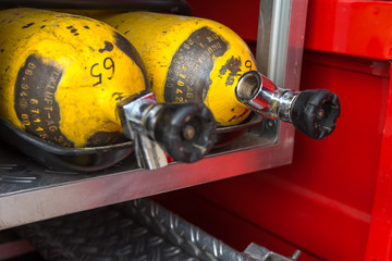 fire extinguishers, oxygen cylinders, masks, fire truck, hoses, firefighters