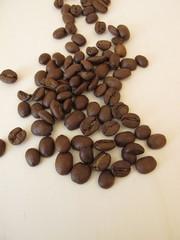 Roasted organic Arabian coffee beans on a wooden board