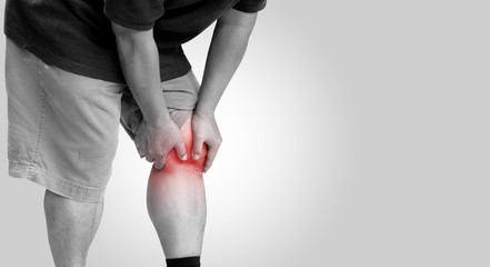 The old man had knee pain as a result of osteoarthritis on a white background, With copy space and clipping path