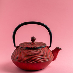 Red cast iron tea pot.