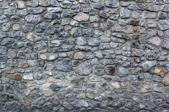 Foundation stones wall of midcentury castle background