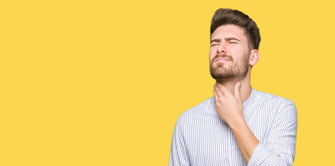 Young handsome man Touching painful neck, sore throat for flu, clod and infection