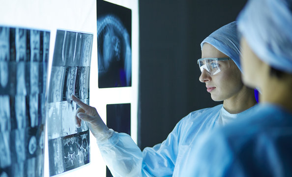 Two female women medical doctors looking at x-rays in a hospital