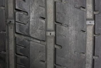 Close up of worn tire with tread wear indicator, minimum legal tread depth