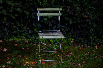 Old chair in a backyard of a farm house