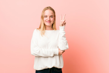 Young blonde teenager woman showing number two with fingers.