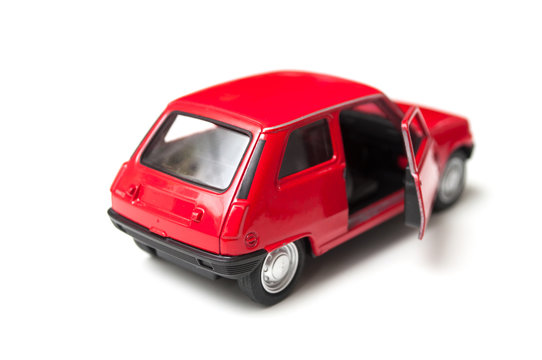 Mulhouse - France - 3 October 2019 - Closeup of red renault 5 miniature toy on white background