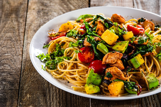 Spaghetti with chicken meat, avocado,mango and cherry tomatoes