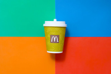 McDonald's paper disposable coffee cup on bright colors mix background