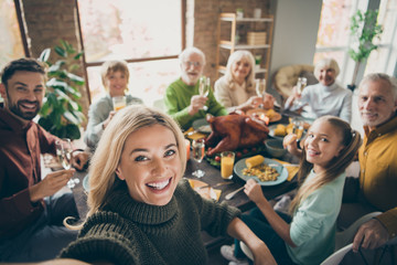 Photo of big family sit feast dishes table around roasted turkey multi-generation relatives making...