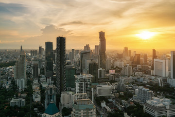 Bangkok, Thailand in Downtown area skyline view during sunset time from rooftop in Bangkok. Asian tourism, modern city life, or business finance and economy concept.