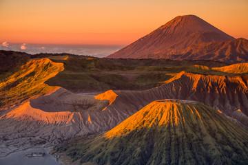 Foto op Plexiglas Diepbruine The beautiful sunrise at Mount Bromo volcano, the magnificent view of Mt. Bromo located in Bromo Tengger Semeru National Park, East Java, Indonesia