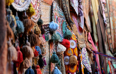 Traditional colorful rugs and carpets are decorated orientally in a carpet store in Cappadocia Turkey.