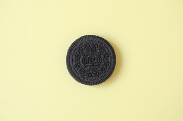 One OREO sandwich cream biscuits on yellow background