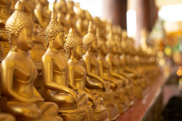 Row of Budda statues, meditation pose, Peace of mind background concept, Copy space