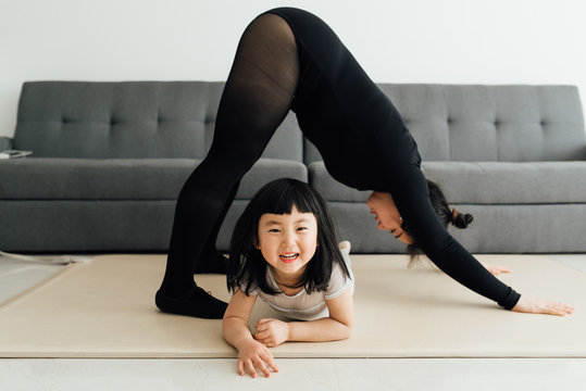 Mom and daughter exercising at home
