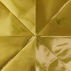 Close up of folded gold origami paper