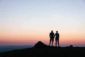 Couple admiring the view at twilight from Little Longstone, Derb