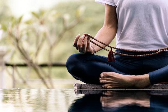 Unrecognizable woman doing yoga