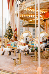 Beautiful horses on merry-go-round in park