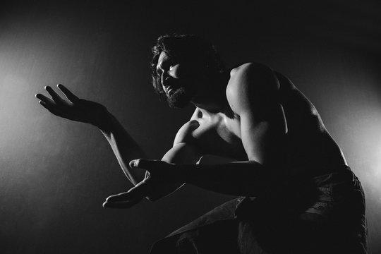 Dancer in shadows.
