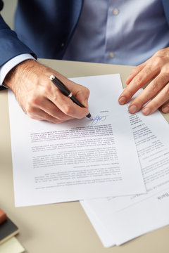 Man putting personal signature on paper