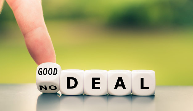 """No deal or a good deal? Hand turns a dice and changes the expression """"no deal"""" to """"good deal"""", or vice versa."""