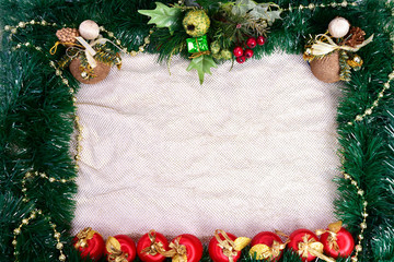 Winter holiday background. Border with Christmas tree branches and ornaments isolated on whitch. Fir needles garland, frame with streamers. Great for New year cards, banners, headers, party posters.
