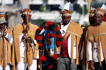 Ethiopian men walk next to their horses during the opening ceremony of Irreecha celebration in Addis Ababa