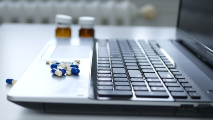 Image from Interior Office with a Laptop and Few Medical Pills