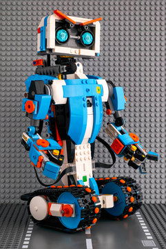 Tambov, Russian Federation - July 27, 2018 Lego BOOST robot standing on the road baseplate against gray baseplate background