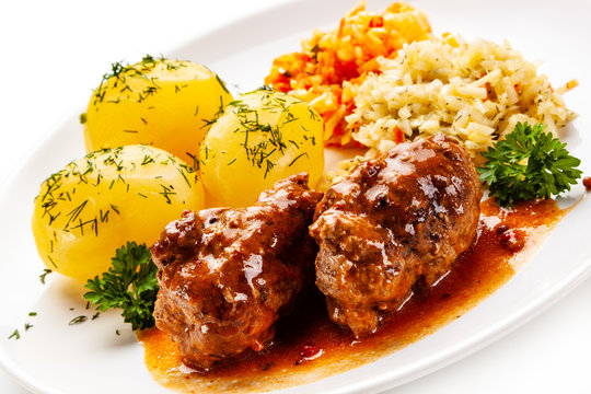 Wrapped pork chop with boiled potatoes