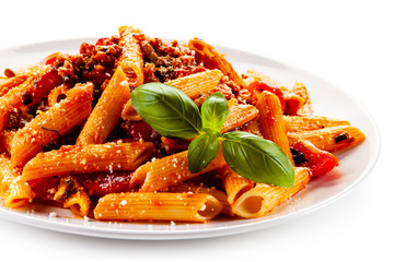 Foto op Aluminium Eten Penne with meat, tomato sauce and vegetables