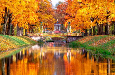 Aluminium Prints Orange Glow Cross bridge and Chinese bridges in Alexander park in autumn, Pushkin (Tsarskoe Selo), St. Petersburg, Russia