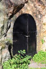 Metal doors on stone facade