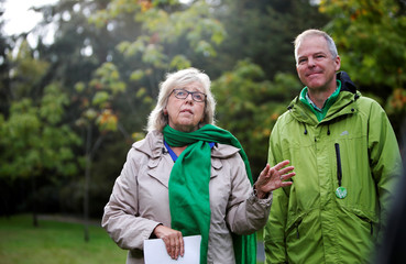 Green Party leader Elizabeth May makes an announcement along with Green Party Member David Merner (Esquimalt-Saanich-Sooke) regarding the role of tree planting in the Green Party's climate plan mission at Gorge Park in Victoria