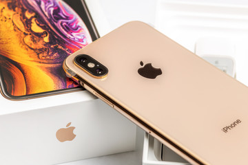 12th October,2018-Kiev,Ukraine: Latest Iphone XS on opened box on white table. Newest Apple smartphone on white branded box in mobile store. Modern gadget with dual camera and OLED screen for sale