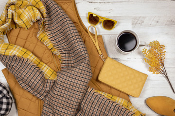 Fall clothing flat lay in mustard yellow color palette