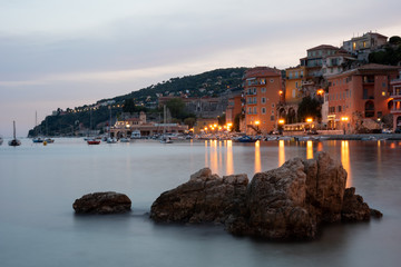 Sea shore in Villefranche-sur-Mer during sunset. Long exposure. Côte d'azur, South of France.  Fototapete