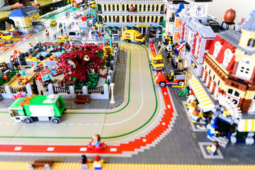 Valencia, Spain - April 13, 2019: Top view of a recreation with Lego figures of a city with buildings and streets.