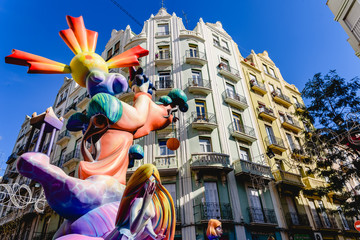 Valencia, Spain - March 16, 2019: Fallas stone cartons of a Falla profusely painted with striking colors, during the Valencian fiestas exposed in the streets before being burned.
