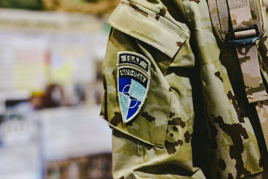 Valencia, Spain - January 4, 2019: Soldier costume with detail of the NATO ISAF badge during a military show.