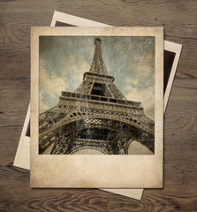 Vintage Eiffel tower instant pictures on wood background