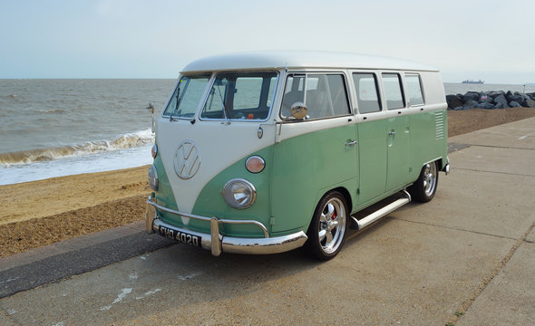 Classic Green and white  VW Camper Van parked on Seafront Promenade.