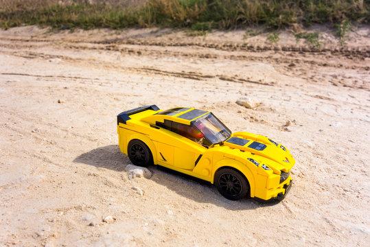Paphos, Cyprus - October 18, 2016 Lego Chevrolet Corvette Z06 on sand road